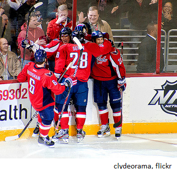 Hockey team celebrating with same uniforms