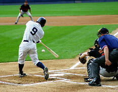 Yankees batter wearing pinstriped uniform