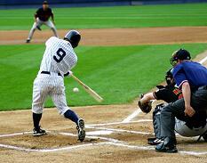 Yankees batter wearing pinstriped uniform