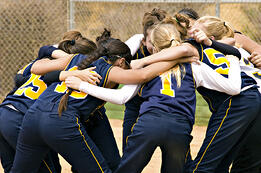 Group of highschool girls with new softball/fastpitch uniforms