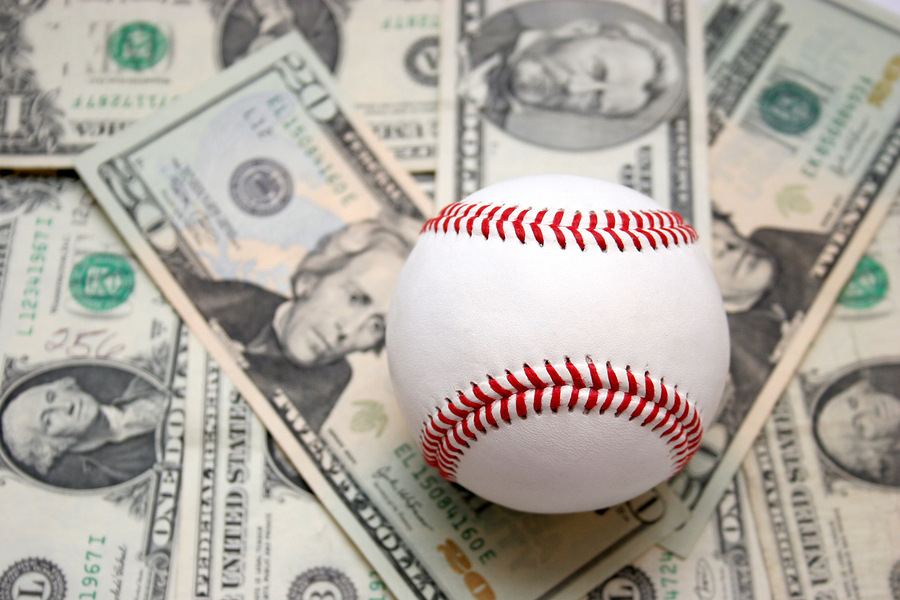 Baseball on a bed of money