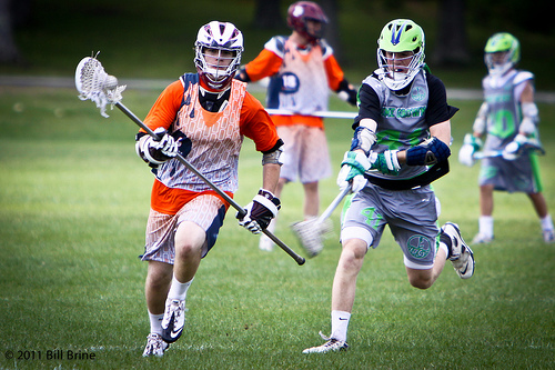 Highschool lacrosse players in sublimated jerseys