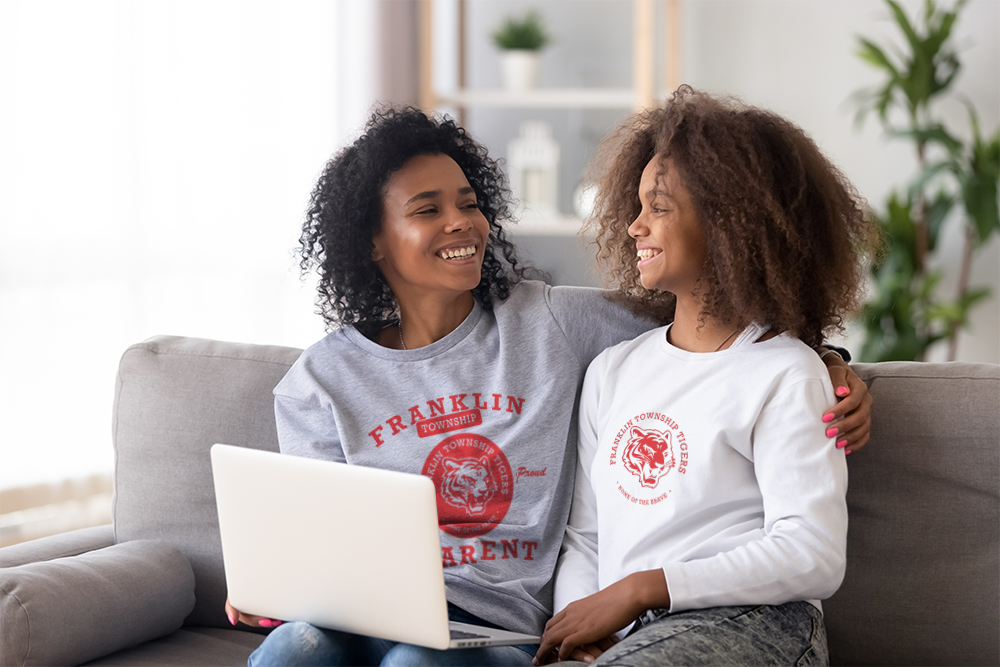 Mother and Daughter wearing spirit wear tee shirts