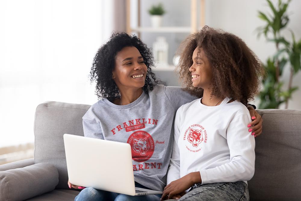 Mother and Daughter wearing spirit wear tee shirts