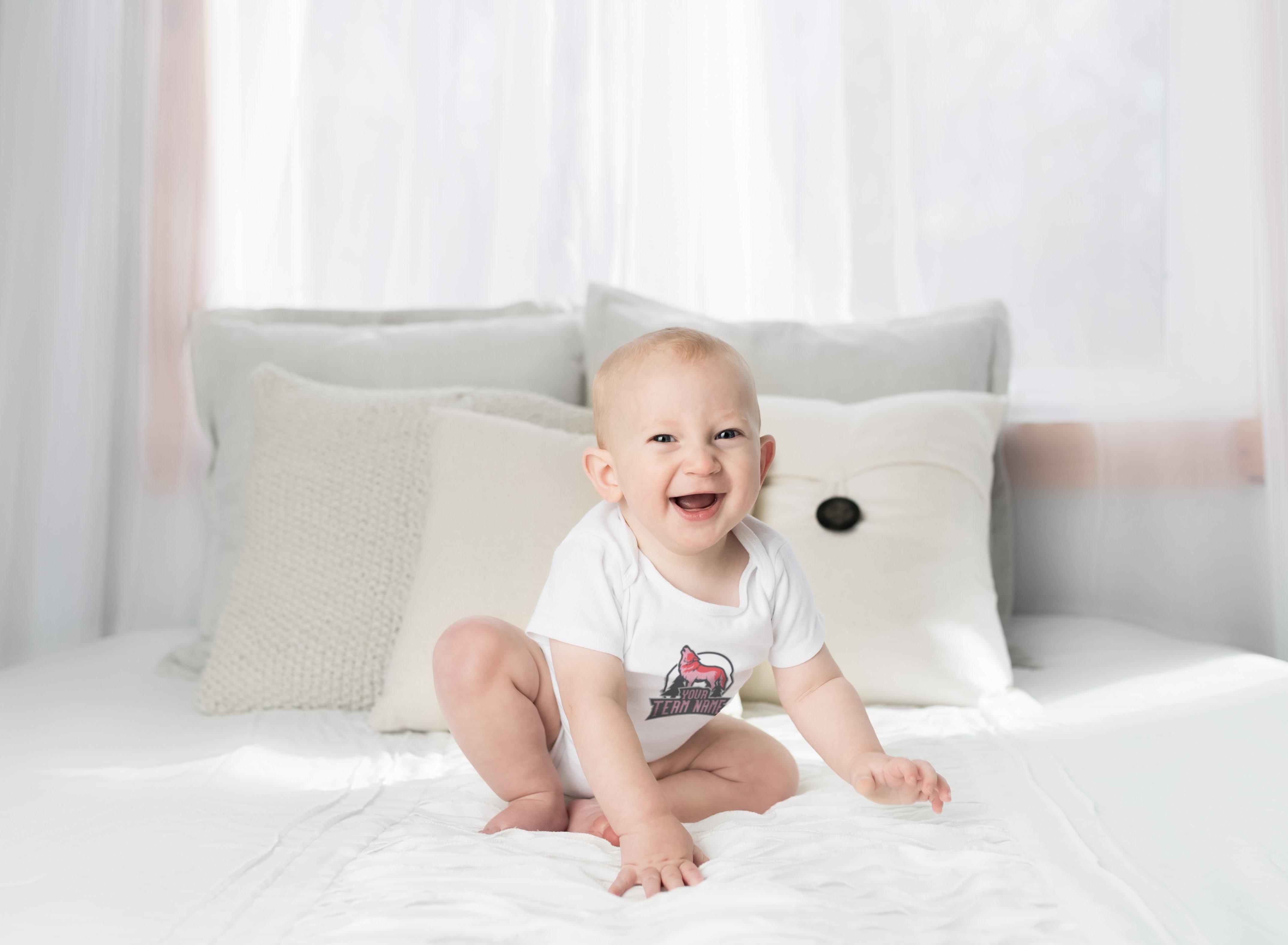 cute baby in a custom decorated onesie