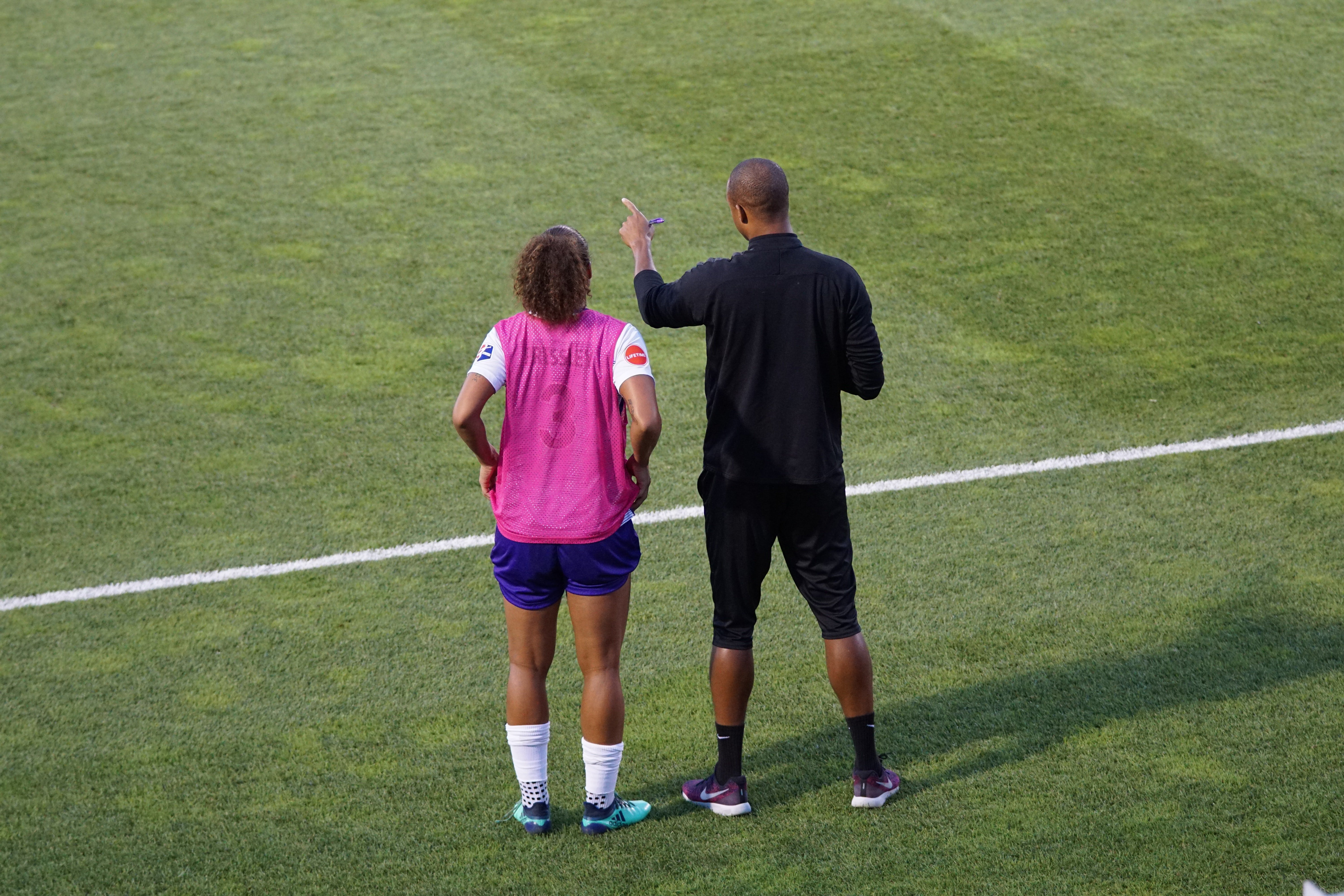 Coach on the field with athlete