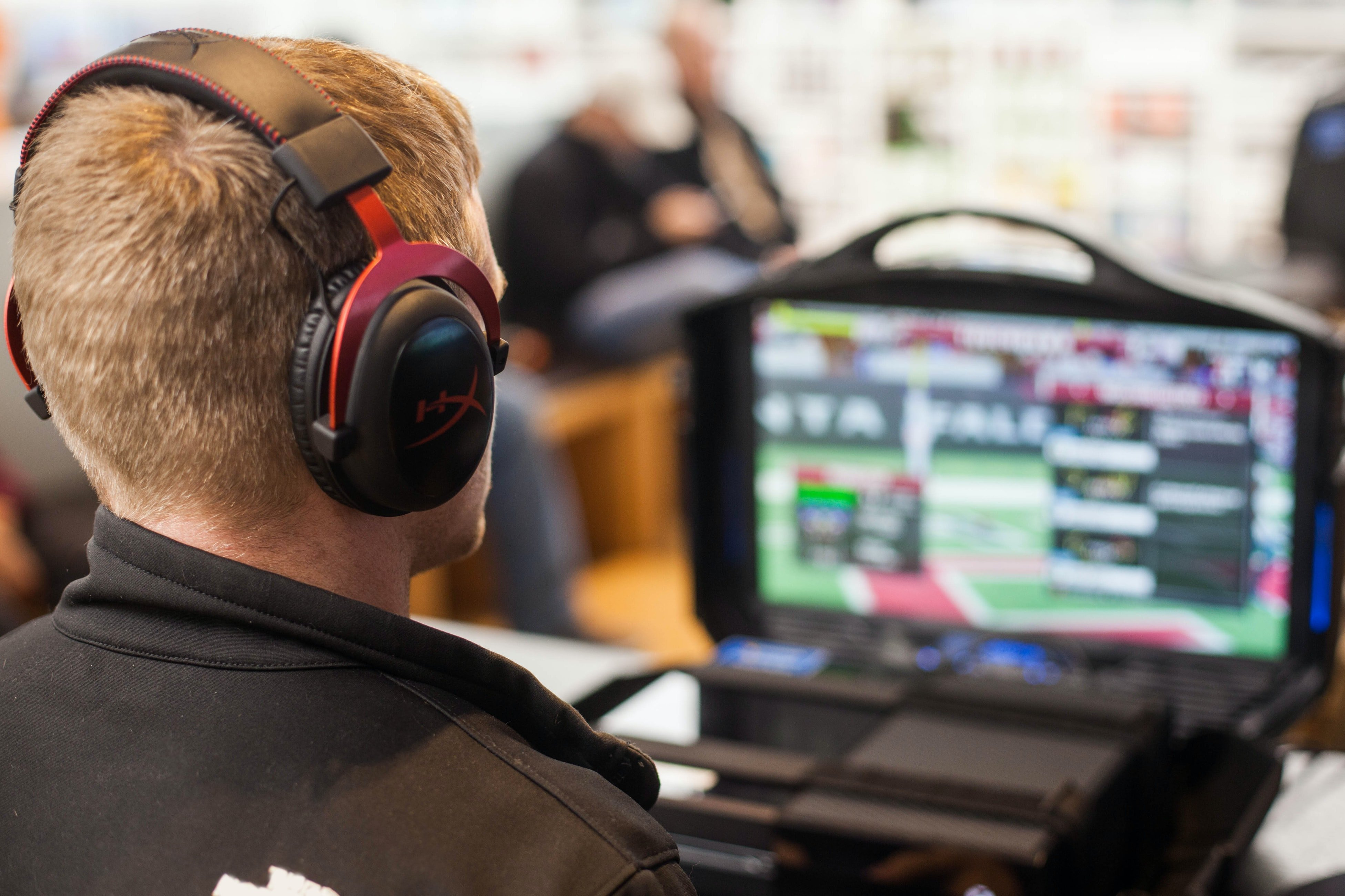 A Career Path Through Esports? | Young man playing professional esports with headset on