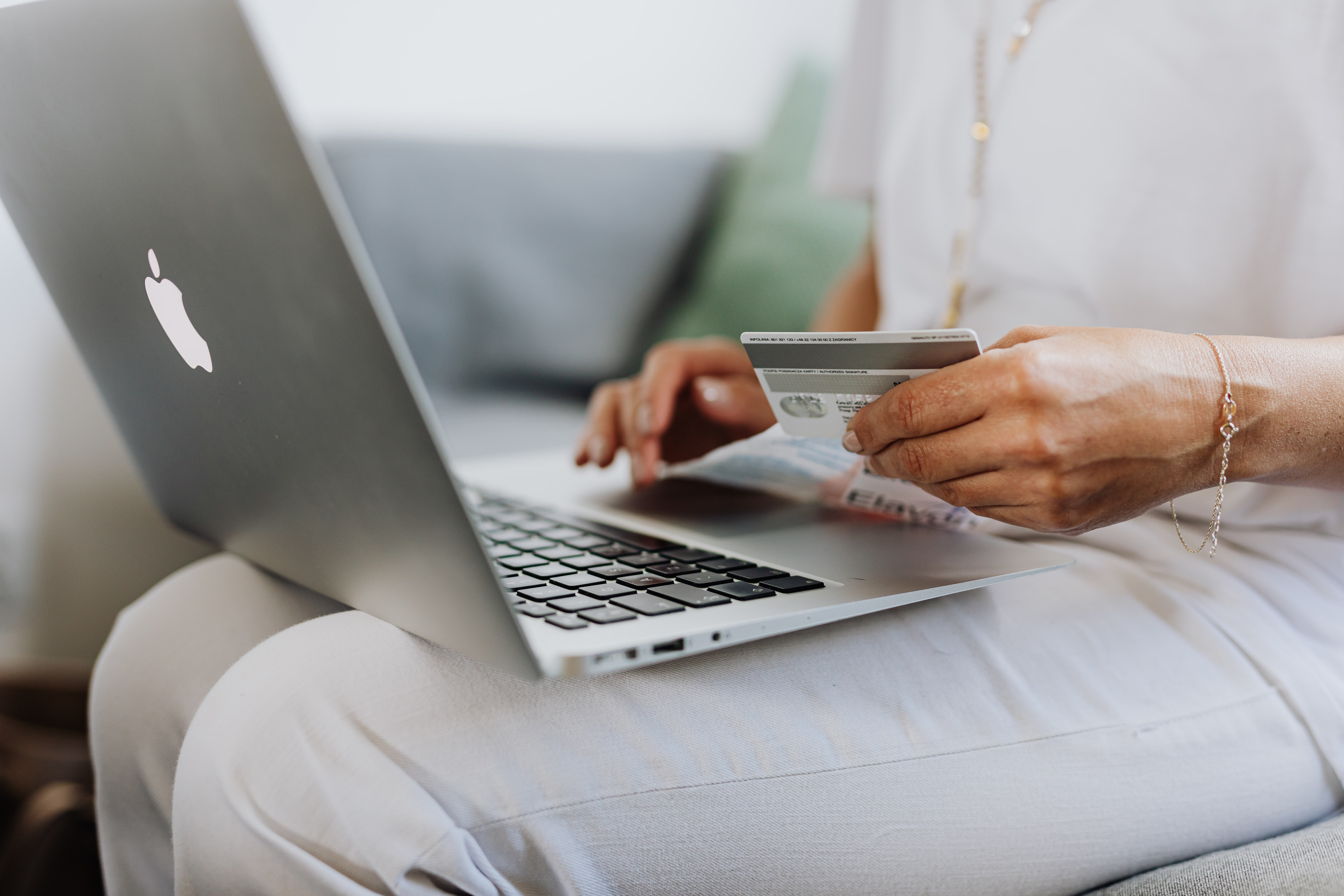 woman holding a credit card online shopping