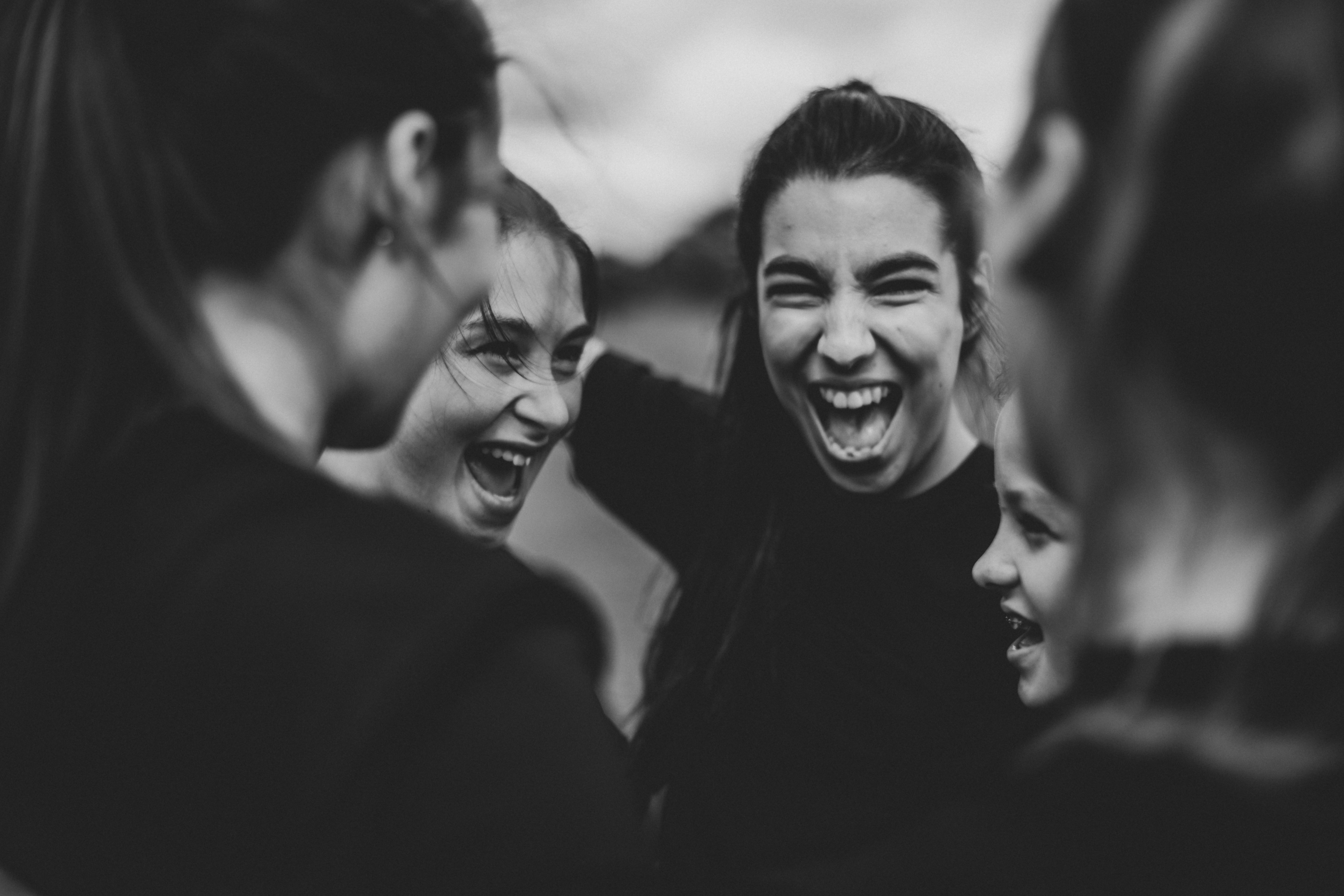 Equality in Sports: Women in a Man's Game | happy young women smiling in a huddle